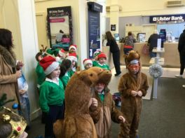 Carol  singing in the Ulster Bank